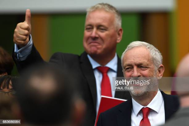 British opposition Labour party leader Jeremy Corbyn smiles before speaking during the Labour election manifesto launch in Bradford on May 16 2017...