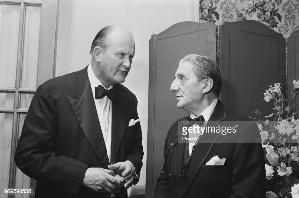 British organist, conductor and composer Thomas Armstrong and British conductor and cellist John Barbirolli at a dinner organised by the Royal...