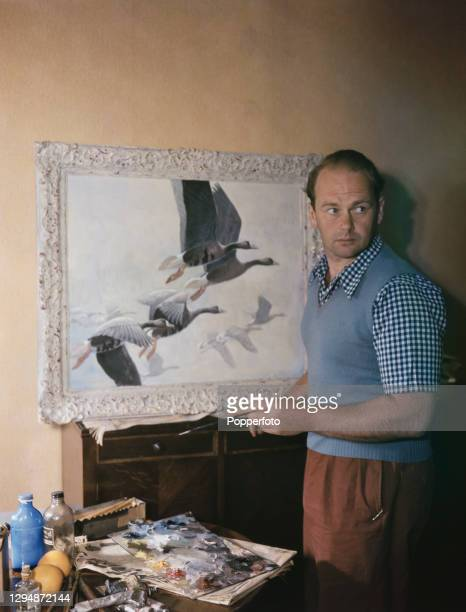 British ornithologist, conservationist and painter Peter Scott paints a scene of birds in flight in his studio in England in July 1947. Peter Scott...