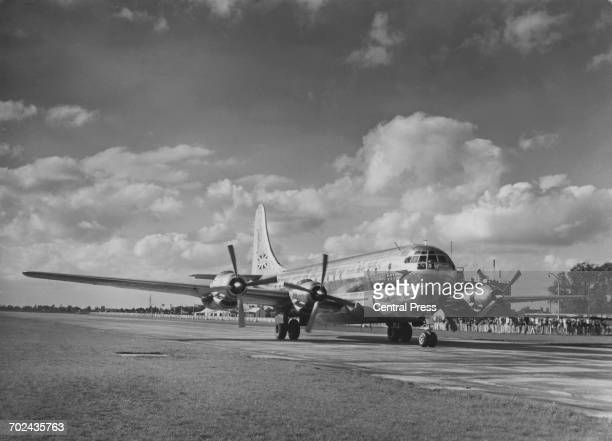 British Overseas Airways Corporation Boeing 377 Stratocruiser longrange piston engined commercial airliner taxing in to London Heathrow airport on 15...