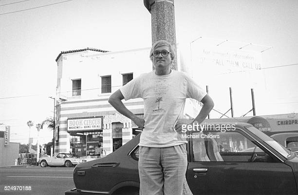 British painter draughtsman printmaker stage designer and photographer David Hockney standing by car in Los Angeles circa 1978