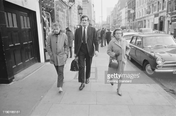 British painter Francis Bacon , on left, walks along Great Marlborough Street in London on 4th January 1971.