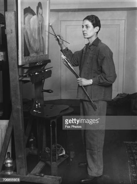 British painter Gluck at work on a portrait in her studio in Hampstead London 4th November 1932 She has recently opened an exhibition at the Fine Art...