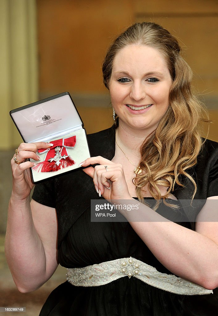 British paralympic swimmer Heather Frederiksen proudly holds her MBE award after the Investiture Ceremony at Buckingham Palace on March 07, 2013 in London, England.