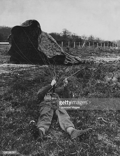 A British paratrooper detaches his parachute after landing during World War II 1944 Original Publication Picture Post 1599 Paratroops pub 18th March...