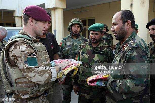 British paratrooper from 3rd Battalion The Parachute Regiment A Company Commander Maj Matthew Cansdale from Winchester England gives to an Afghan...