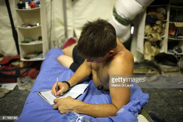 British paratrooper from 3rd Battalion The Parachute Regiment Lcpl Kavin Fryer 22yearsold from Fleetwood is seen in his tent writing a letter during...