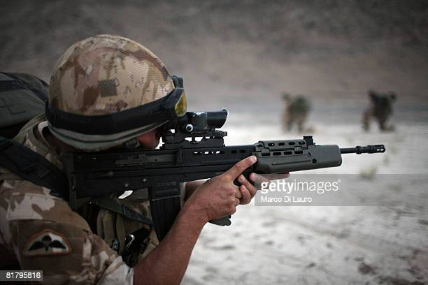 British Paratrooper from the 3rd Battalion The Parachute Regiment aims his rifle during an operation to search three compounds and look for weapons...