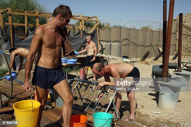British Paratroopers from the 2nd Battalion The Parachute Regiment collects water for laundry on July 9, 2008 in Gibraltar FOB in Upper Gereshk...