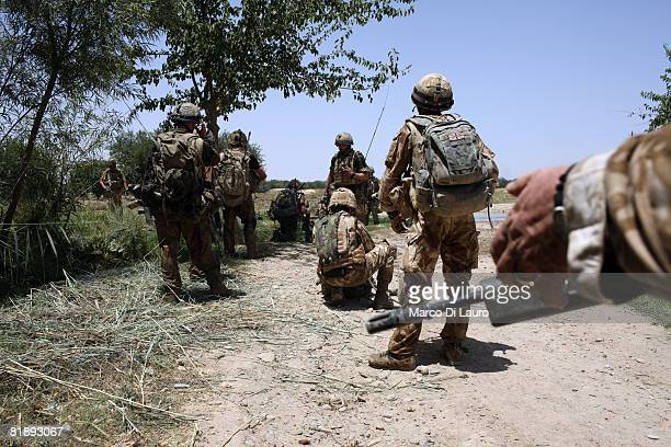 British Paratroopers from the 2nd Battalion The Parachute Regiment are seen on the ground to rescue their injured fellow battalion members shot by a...