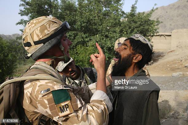 British Paratroopers from the 3rd Battalion Parachute Regiment detain suspected Talibans during an operation to capture Taliban leaders on July 5...