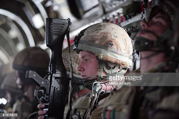 British Paratroopers from the 3rd Battalion Parachute Regiment fly from their base at the Kandahar Air Field as they deploy during an operation to...