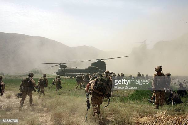 British Paratroopers from the 3rd Battalion The Parachute Regiment board a Chinook helicopter to return to their base after they detained some...