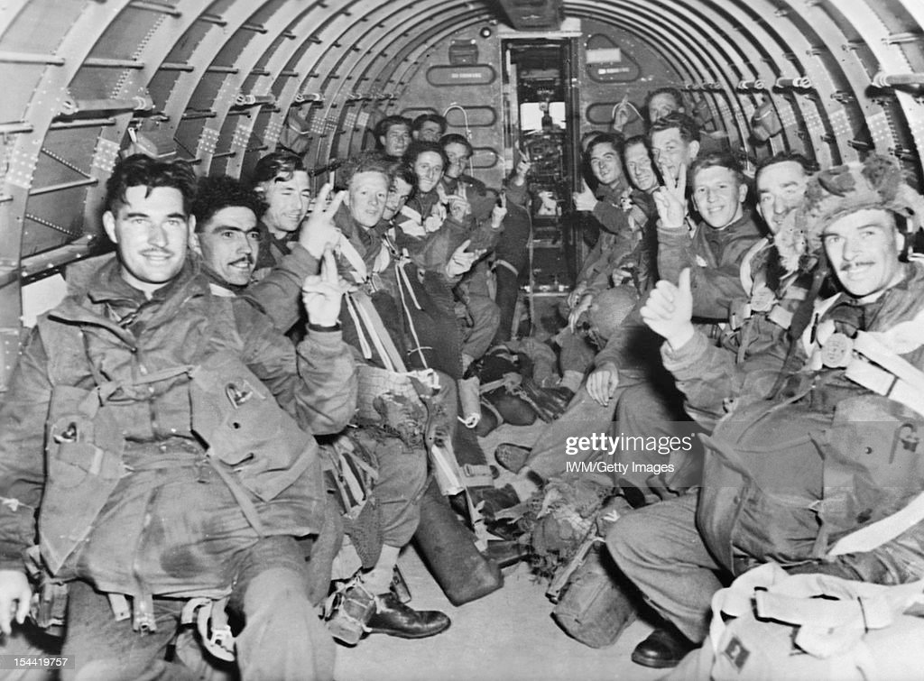 British Paratroops On Way To Land In Holland, 17 September 1944, British paratroops inside a C-47 transport plane to land with the First Allied Airborne Army on enemy-held Holland, 17 September 1944.