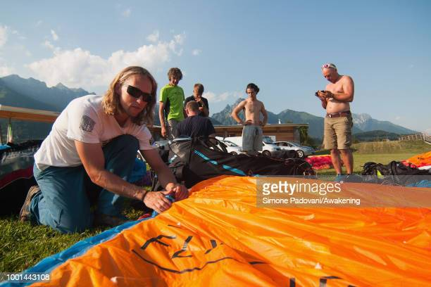 British participant sets up his paraglider at the landing area Boscherai after the training on July 18 2018 in Feltre Italy Richard Butterworth...