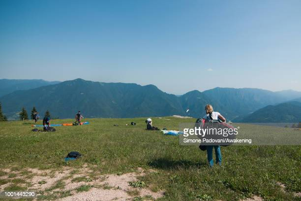 British participants arrive at the takeoff area at Monte Avena before the training on July 18 2018 in Feltre Italy Richard Butterworth starts...