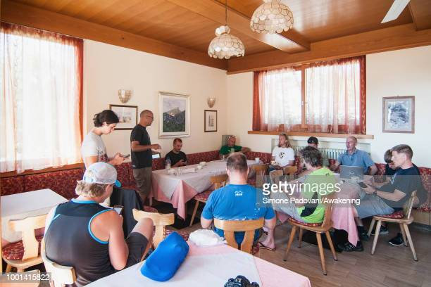 British participants attend the morning meeting before the training on July 18 2018 in Feltre Italy Richard Butterworth starts training with his team...