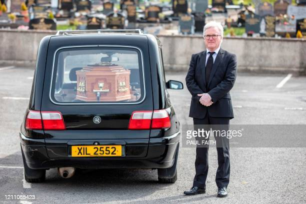 British Patrick Blake funeral director poses outside Saint Ninnidhs church in Derrylin Northern Ireland on April 22 2020 during the COVID19...