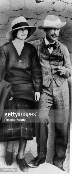 British patron of archaeological exploration George Herbert Fifth Earl of Carnarvon and his daughter Evelyn stand near to the entrance to the tomb of...