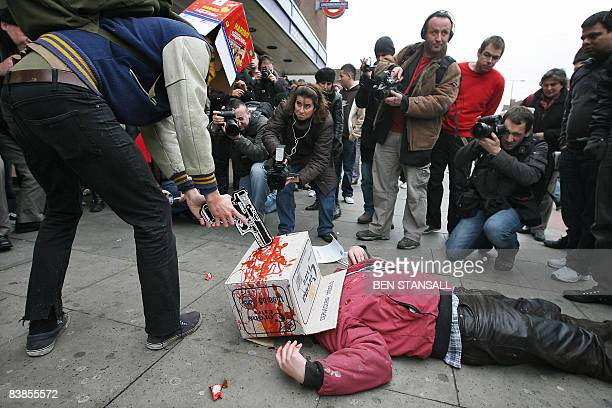 British performance artist Mark McGowan performs a reenactment of the shooting of Charles de Menezes at Stockwell Station on November 29 2008 in...