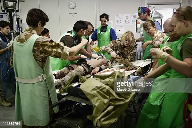 British personnel of the United Kingdom Med Group perform a cardio-pulmonary resuscitation to a wounded British soldier who had a traumatic...