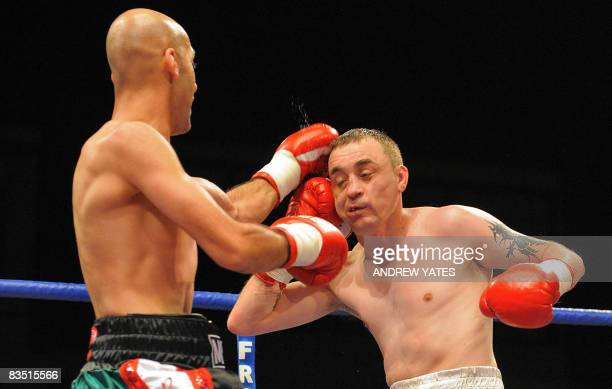 British Peter Buckley is punched by countryfellow Martin Mohammed on his way to winning on points during their Light Welterweight boxing match at the...