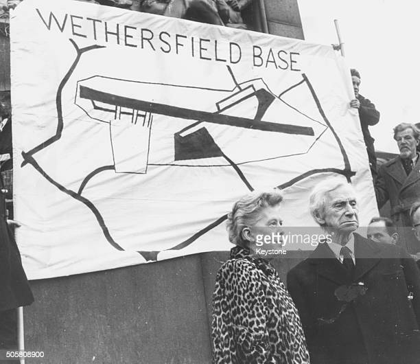 British philosopher and social activist Bertrand Russell and his wife Lady Russell pictured standing in front of a Ban the Bomb Committee of 100...