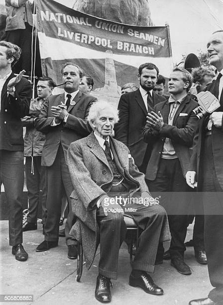 British philosopher and social activist Bertrand Russell pictured listening to one of the speakers at a National Union of Seamen rally in Trafalgar...