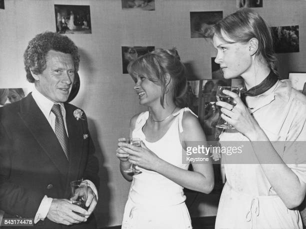 British photographer and film director David Hamilton with two models at the 30th Cannes Film Festival in France 23rd May 1977