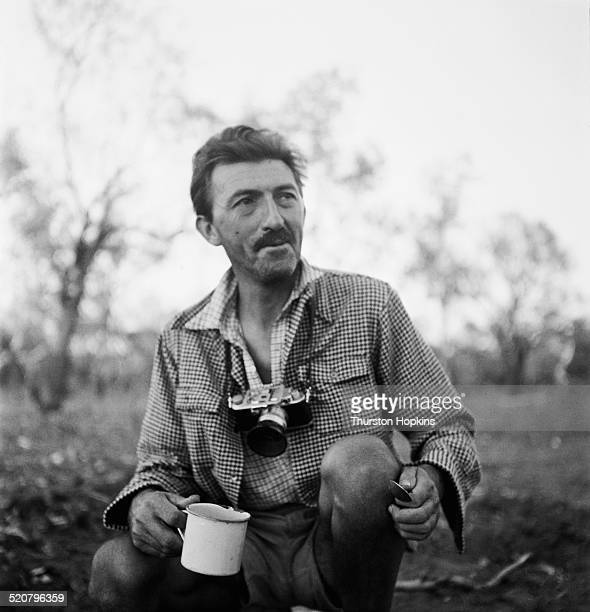 British photographer and photojournalist Thurston Hopkins on a cattle ranch in Australia circa 1953 Original Publication Picture Post 6832 Cattle...