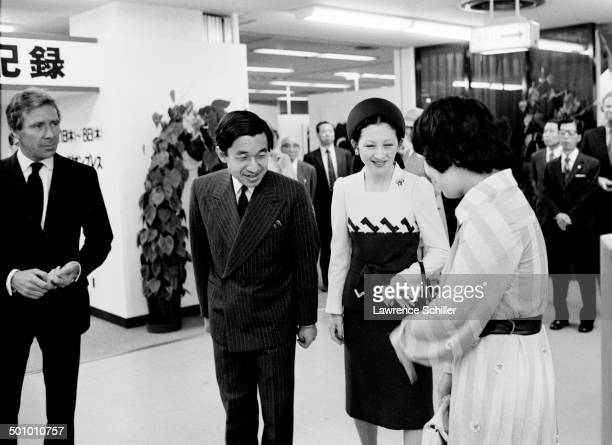 British photographer Antony ArmstrongJones 1st Earl of Snowdon watches as a curator greets Japanese thenCrown Prince Akihito and thenCrown Princess...