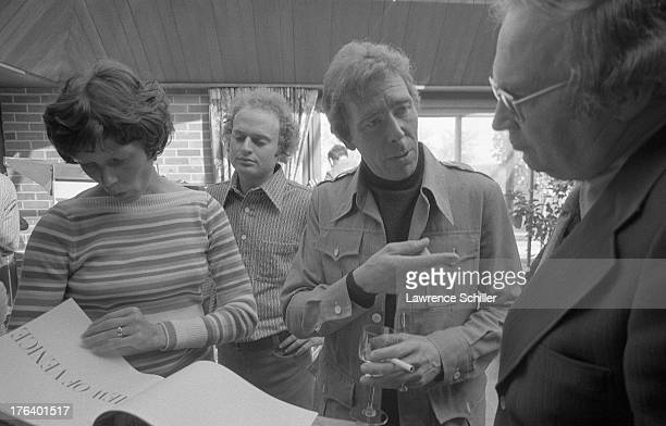British photographer Antony ArmstrongJones 1st Earl of Snowdon speaks with unidentified others as he sets up an exhibition of his work entitled...