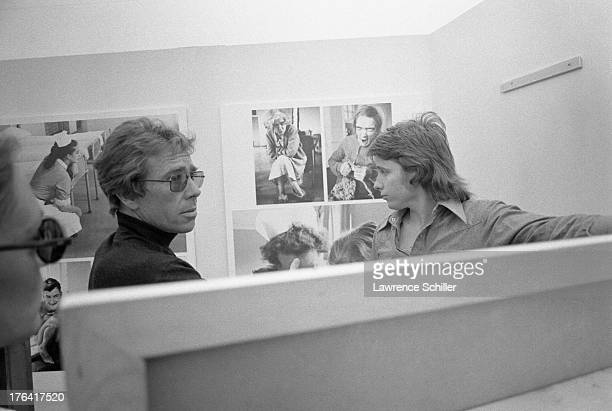 British photographer Antony ArmstrongJones 1st Earl of Snowdon with an unidentified man arranges an exhibition of his work entitled 'Assignments' Des...