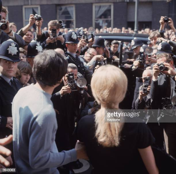British photographer David Bailey and French actress Catherine Deneuve on their wedding day on the steps of St Pancras registry office, London,...