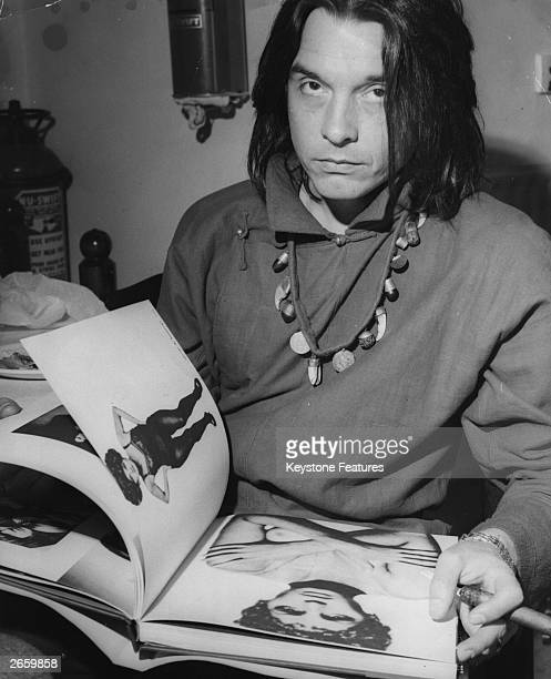 British photographer David Bailey flicking through his photographic epitaph to the 1960's 'Goodbye Baby and Amen'