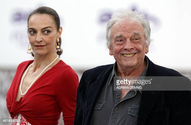 British photographer David Bailey smiles as he arrives with his wife Catherine Dyer Bailey for a charity gala dinner at Kensington Palace in London...