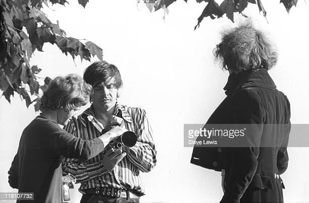 British photographer David Bailey with a model and an assistant London circa 1970