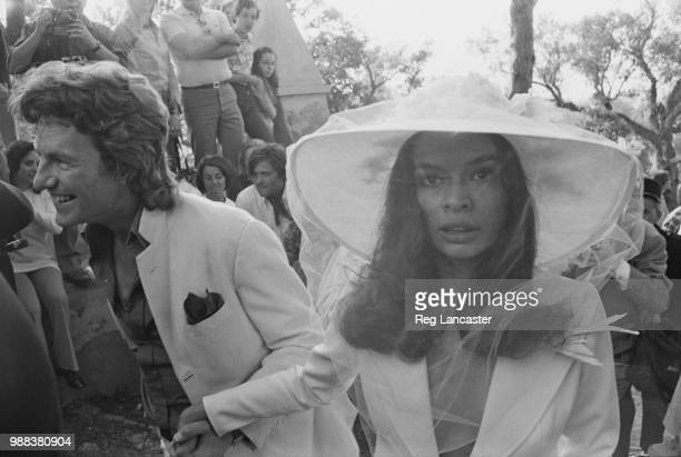 British photographer Patrick Lichfield with Bianca De Macias at her wedding to Mick Jagger in St Tropez 12th May 1971