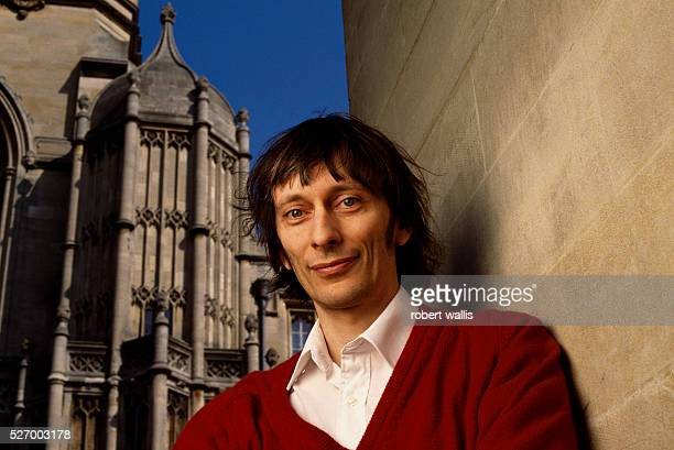 British physicist, David Deutsch, in front of King's College.