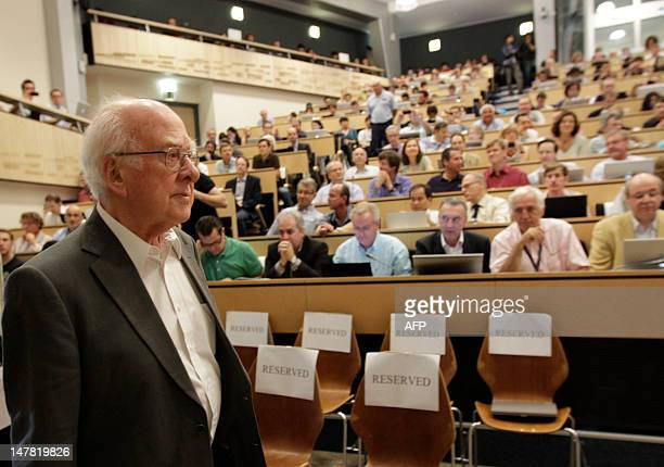 British physicist Peter Higgs arrives on July 4 2012 for the opening of a seminar to deliver the latest update in the 50year bid to explain a riddle...