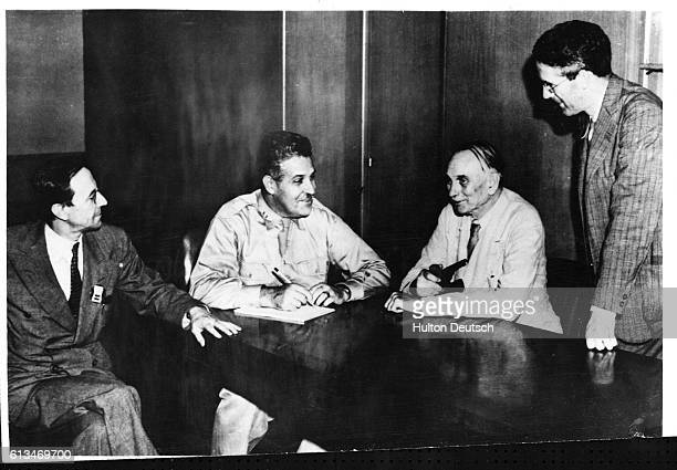 British physicist Sir James Chadwick with scientist involved in the American Manhattan Project' which during World War II developed an American...