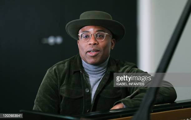 British pianist and composer Alexis Ffrench poses for a photograph after giving an interview at Steinway & Sons in London on February 19, 2020. -...