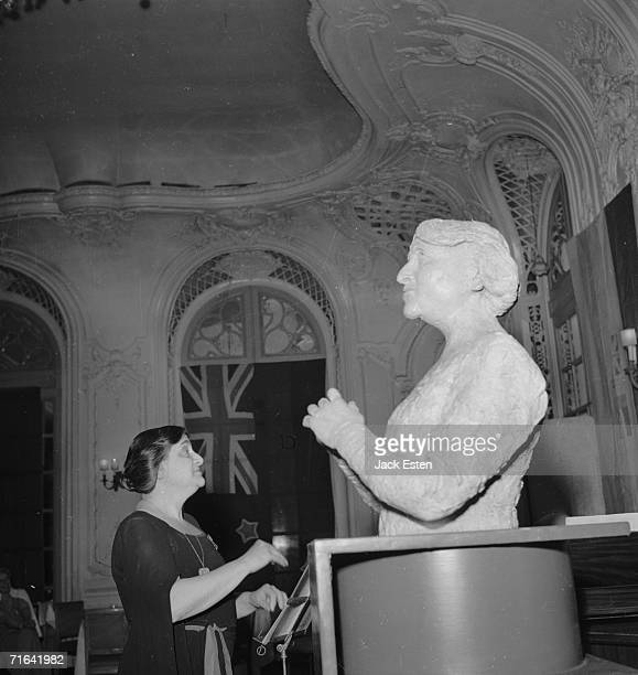 British pianist Dame Myra Hess conducts Haydn's 'Toy Symphony' of toy musical instruments at the Savoy Hotel London 14th July 1945 In the foreground...