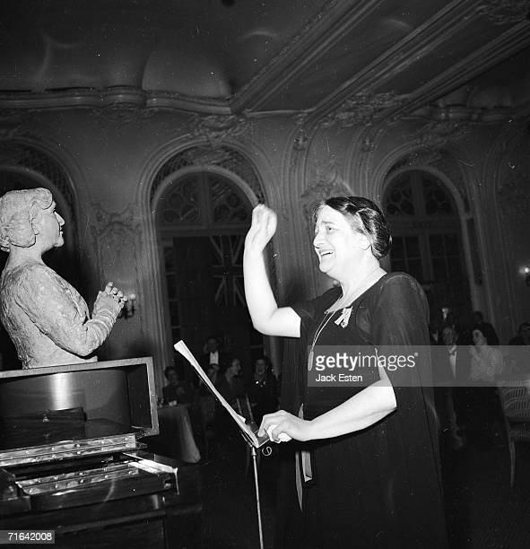British pianist Dame Myra Hess conducts Haydn's'Toy Symphony' of toy musical instruments at the Savoy Hotel London 14th July 1945 On the left is a...