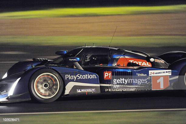 British pilot Anthony Davidson steers his Peugeot 908 HdiFAP N°1 during the 78th edition of the Le Mans 24hour endurance race on June 12 in Le Mans...