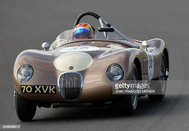 British pilot Chris Ward drives a 1952 Jaguar Type C as he competes in a race for cars dating from the 1949 and 1956 during the 8th edition of Le...