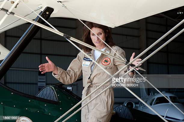 British pilot Tracey Curtis stands on the Vintage Boeing Stearman biplane on November 2 2013 at Cape Town airport she will fly from Cape Town to...