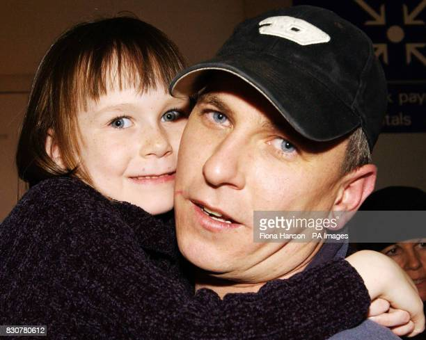 British Plane spotter Andrew Jenkins of York reunited with his daughter Lisa Hodgson age 6 at Luton Airport after being held in captive for five...