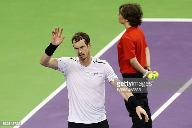 British player Andy Murray celebrates after winning against France's Jeremy Chardy on the fourth day of the ATP Qatar Open tennis competition in Doha...