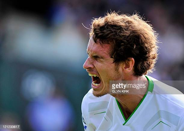British player Andy Murray gestures as he plays against German player Tobias Kamke in a Men's Singles match at the 2011 Wimbledon Tennis...